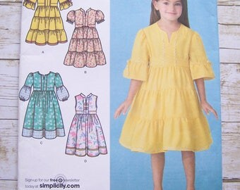 Simplicity 3900 girls dress with variation sizes 3-8