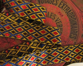 3 yards  PHINEAS Jacquard trim with Blue and  metallic gold cross hatching and Red and Black diamonds. 1 1/2 inch wide. 2060-D