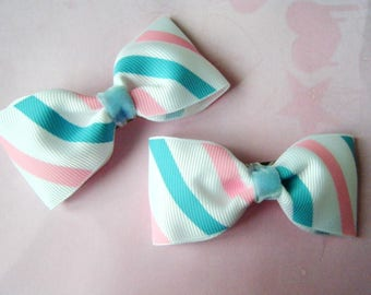 2 pink and blue striped bars