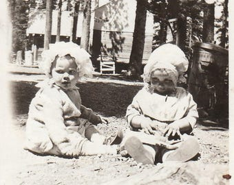 Original Vintage Photograph Snapshot Baby Girls Wearing Bonnets Sitting Outdoors 1920s