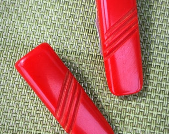 1930s Red Bakelite Carved Shoe Clips