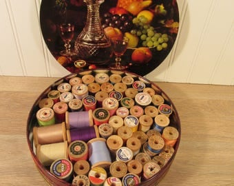 60+ wood spools of thread in a round mid century tin with lid- vintage- sewing supplies- sewing notions