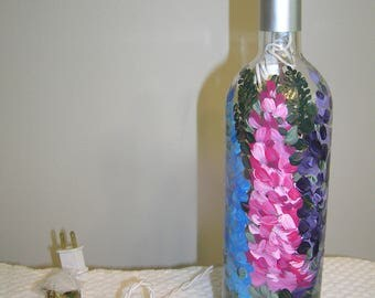 Lighted Wine Bottle Delphiniums