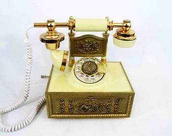 Vintage French Style Rotary Phone with Ivory Colored Body and Brass Accents. Circa 1970's.