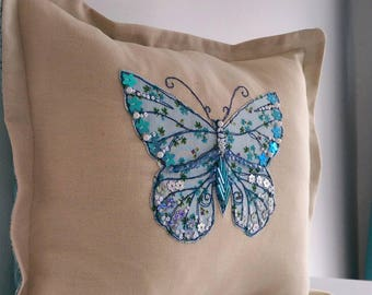 Beaded Butterfly decorative pillow. Freehand machine embroidery hand stitched beads and sequins. Oxford style with plaid backing.