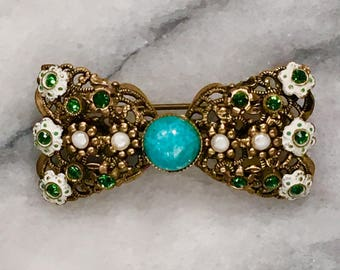 Very Vintage 1930's brass filagree bow brooch with turquoise enamel flowers and sparking green rhinestones. Marked Made in Germamy West