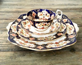 4 pc. Royal Albert Heirloom tea set, Crown China imari pattern set includes Teacup, saucer, bread and butter and platter excellent condition