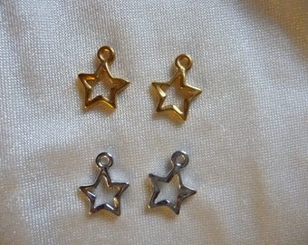 Charms, 14x10mm Gold and Silver Open Star. Sold per pack of 4.  2 Gold and 2 Silver per pack.