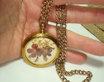 Vintage Pressed Violet Flowers in a Gold Tone Pendant Necklace.