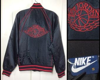 AJ1 1980's 1985 Air Jordan wings basketball satin bomber jacket size small black red original logo AJ-1 blue tag Nike