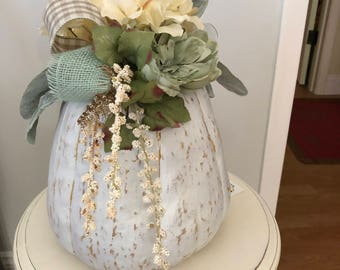 White lightly distressed Pumpkin topped with Flowers and Ribbons.