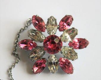 Vintage pink crystal brooch. Pink rhinestone brooch.  With original safety chain.  Vintage jewellery
