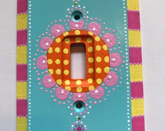 Single toggle light switch plate blue with pink blossom.