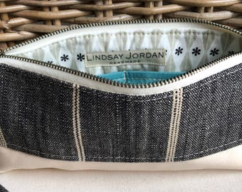 Black and off-white LINEN & ivory sheepskin LEATHER  wristlet pouch: icy boue teal pockets | gray, black, white patterned lining