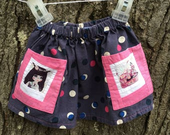 Blue polka dot skirt with picture pockets