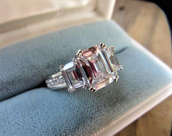 Estate Pristine Emerald Cut CZ Sterling Silver Ring 4KT Total Weight Size 6 Can be resized
