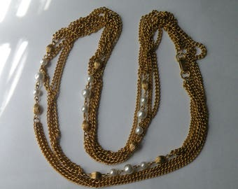 "Faux pearl gold plated chain necklace. 54.25""long."