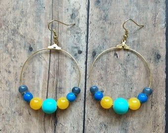 Blue and yellow beaded dangle earrings