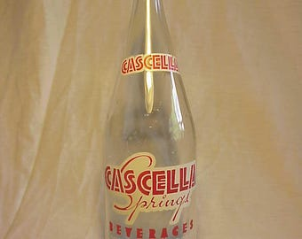 1969 Cascella Springs Beverages Cascella Springs Bottling Co. Three Rivers, Mass., 32 ounces Clear Glass ACL Painted Label Soda Bottle