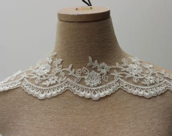 Alencon Ivory Beaded Lace trim with Faux Pearls. 4 inches wide.