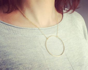 Geometric large circle necklace - A circle is a symbol for a goddess & the sun. It can represent infinity, being complete, and being whole.