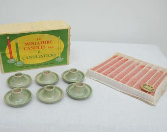 Six Ceramic Candlestick Holders and 10 Candles
