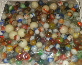 We found your marbles! From the early 1900's....its the real thing.