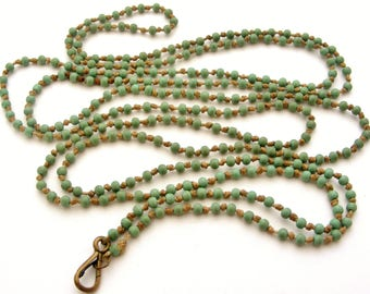 Turquoise green early plastic long guard lanyard with brass dog clip