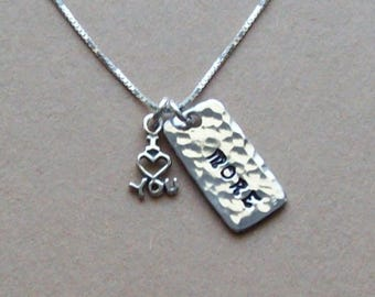 """I love you more pendant necklace of hammered solid aluminum with sterling silver """"I (heart) you"""" charm on a sterling silver chain."""