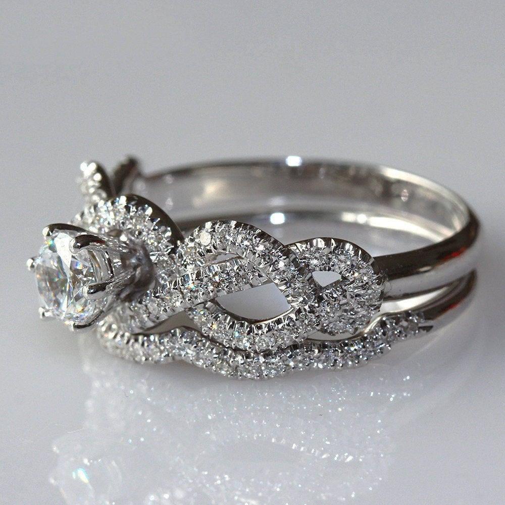 infinity knot diamond engagement ring with diamond band 14k