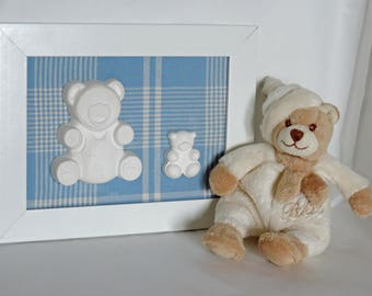 White painting with two chalk in the shape of teddy bears