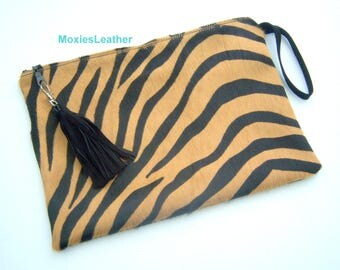 Hair on hide clutch purse monogrammed with suede back and tassel