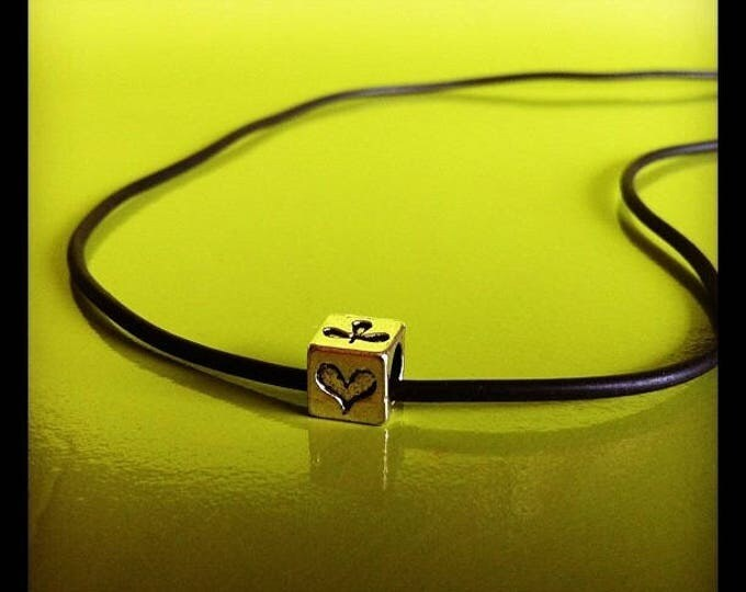 Black rubber and cube POKER charm necklace