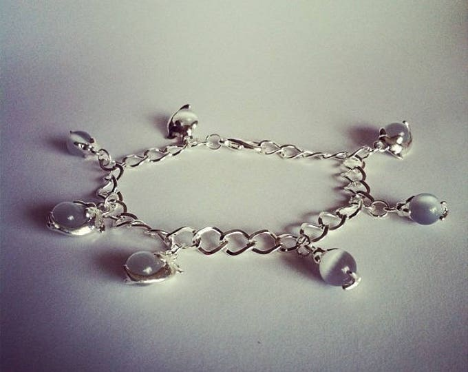 Dolphins charm bracelet grey glass beads