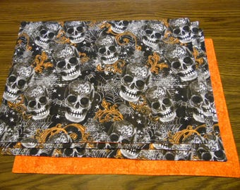 Human Skulls Set of 4 Placemats with Bursting Skulls with Marbled Orange Fabric on Reverse Side, Halloween Place Setting