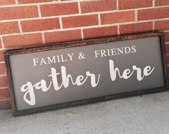 Family and friends gather here painted solid wood sign