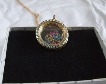 Living locket with charms