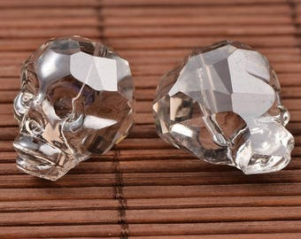Skull bead in transparent grey glass, faceted - individually