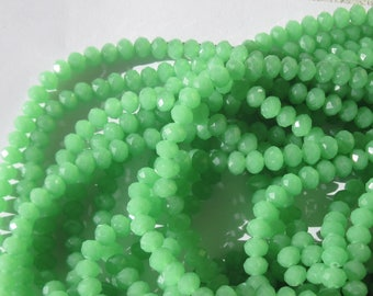 30 glass beads green faceted 3 to 4 mm approx (18)