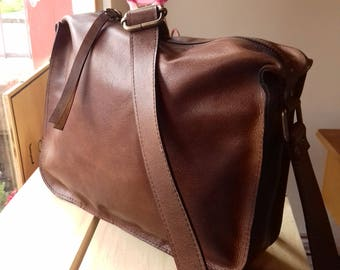 Leather handbag, messenger type, hand sewn, soft leather for appearance and touch. Lightweight handbag, 100% leather.