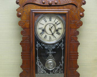 "Waterbury Clock, Striking, ""Bronson"" Model, Walnut 30 Hour, All Original with Original Label on Back"