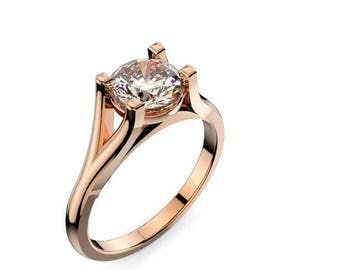 Solitaire Engagement Ring with a 1 Carat Round Diamond  in 14kt