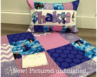 New! Toddler quilt made from licensed Frozen fabric, in pink blue and purple.