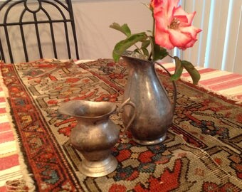Vintage small metal pitchers, one is pewter