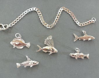 So Many Fish In The Sea Charm Bracelet - one fish, two fish...or as many as you want! In sterling silver on sterling silver heavy curb chain