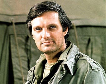 Alan Alda (as  Hawkeye  Pierce ) in a publicity photo from the CBS Television sitcom  M A S H