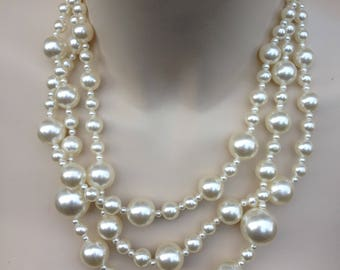 Necklace - gorgeous three string beaded plastic pearl necklace