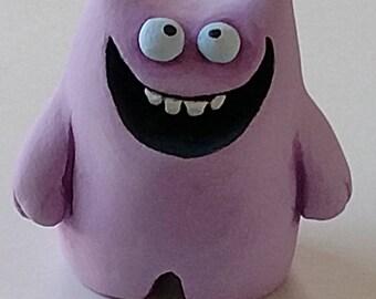 Purple polymer monster sculpture