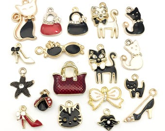 18 charms deluxe collection gold tone and enamel,12mm to 28mm  #ENSA 419