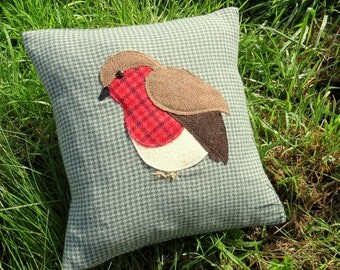 Christmas cushion. A festive robin on tactile wool.  Robin pillow.  Complete with a feather pad.
